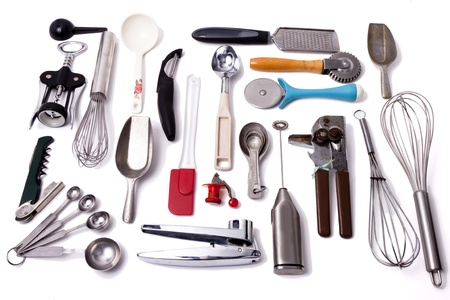 A collection of kitchen tools and utensils on a white background  photo