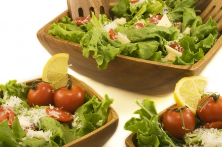 A free salad of lettuce, tomatoes, and cheese in wooden bowls  photo