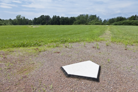 a rural community: Home plate of a baseball diamond in a rural community. Stock Photo