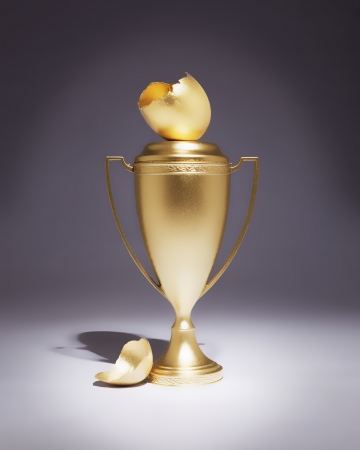 A trophy with cracked golden egg