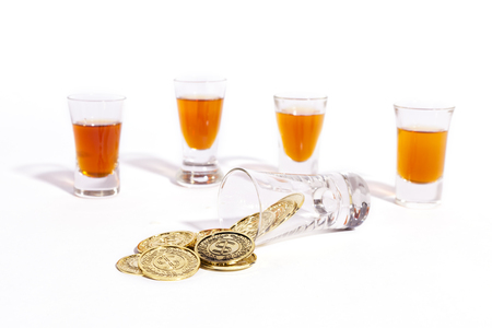 Coins and Four Shot Glasses