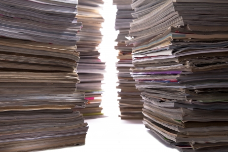 out dated: Several large building like stacks of old magazines. Stock Photo