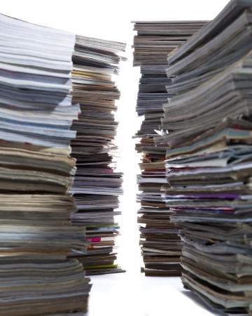 Several large building like stacks of old magazines. Banco de Imagens