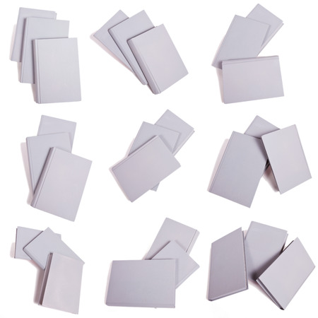 Nine isolated groups of three gray books in various positions. Copy space.