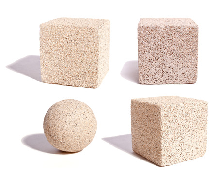 3-Dimensional objects made of stone material against a white background.