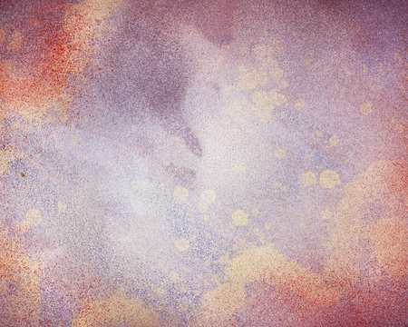Splattered spray paint in a decorative background design.