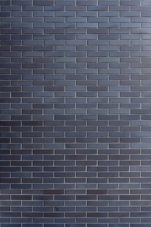 vizualisation: The wall made of dark clinker bricks - tiled.  Wrapped around texture, ready to use in 3d vizualisation.
