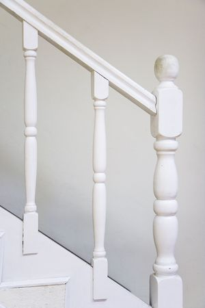 Old wooden stairs with baluster � white painted. photo