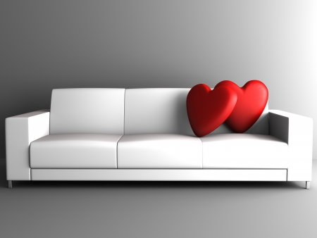 red heart on white sofa in room