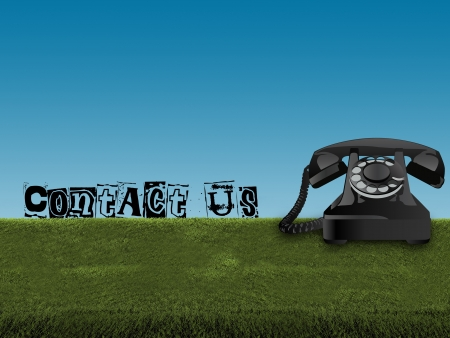 contact us on old telephone in green field and blue sky Stock Photo