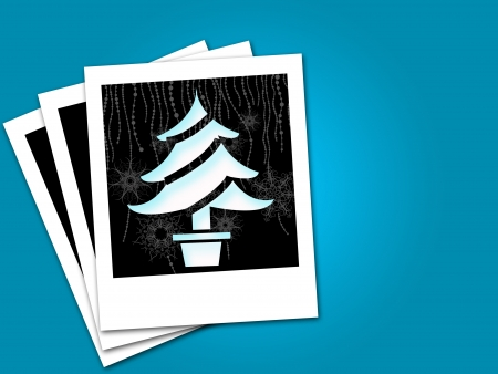 christmas tree in black frame isolated blue background photo