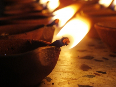 deepavali oil lamps enlighten photo