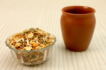 sev: namkeen in glass bowl with ceramic cup