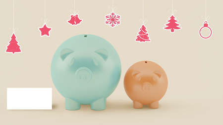 christmas debt: using piggy money on christmas celebration with blank card at right Stock Photo