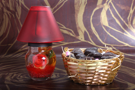 decorated red lamp with metallic bowl, home made chocolates concept Stock Photo