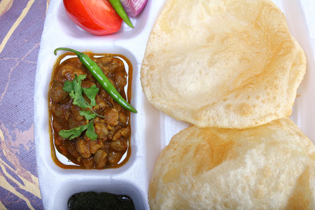 chaat: spicy chole bhautre, with green chili toppingindian dish
