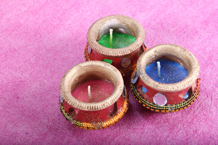 three beautifully decorated candle pot
