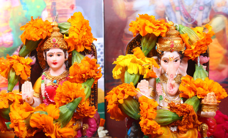 parvati: goddess lakshmi and lord ganesha at the time of prayer