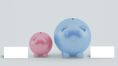 two different size piggy banks with blank white card Stock Photo