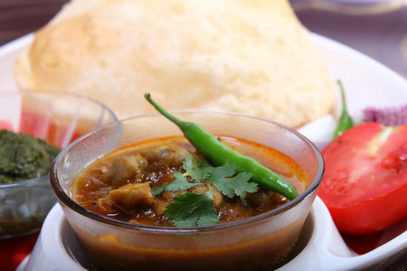 chaat: spicy chole bhautre, with green chili topping indian dish Stock Photo