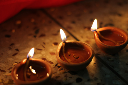 oil lamps lit on diwali festival