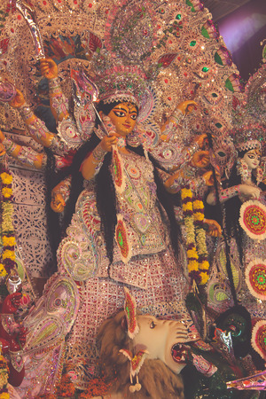worshipped: Durga Idol as worshipped by Bengali community in India. Known as goddess of destruction, she is also called Kali. View from side