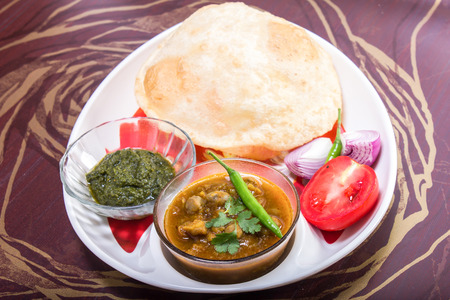 chaat: spicy chole bhautre, with green chili topping, indian dish Stock Photo