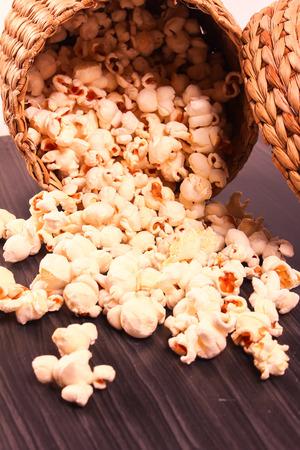 wooden block: popcorn in bowl spreading on wooden block