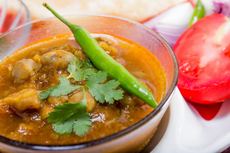 chaat: spicy chana masala, with green chilli topping, indian dish Stock Photo
