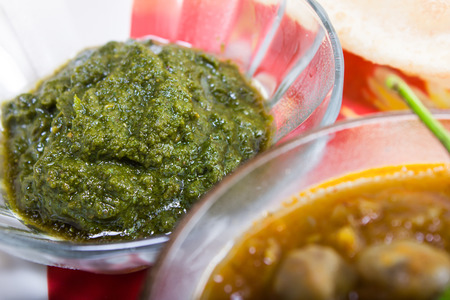 chutney: green chutney served with chickpeas and bhature Stock Photo