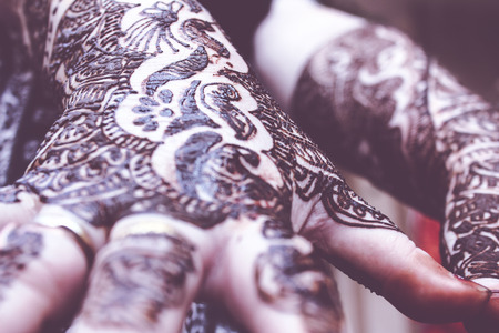 indian culture tradition: designing mehandi is applied on both hands, celebration concept