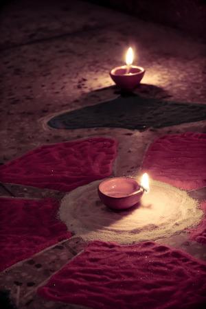 oil lamp at center of colorful rangoli photo
