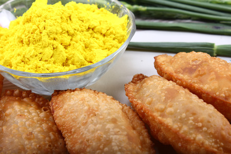 pista: gujia, indian traditional snacks for holi festival with green color in bowl Stock Photo