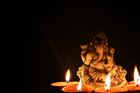 god ganesh: lord ganesha with beautiful diya at diwali