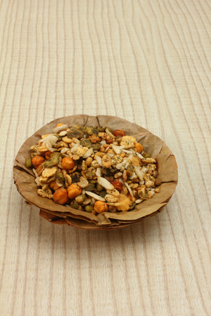 sev: delicious namkeen mixture in patta bowl, indian style Stock Photo