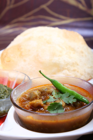 spicy chole bhautre, with green chili topping, indian dish Stock Photo