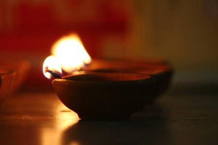 earthen lamp - diya on floor removes the darkness and spread illumination