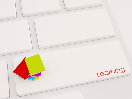 e-learning concept, books on key with text on keyboard Stock Photo