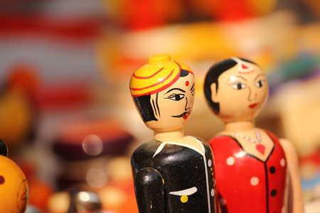fair woman: beautiful couple clay dolls in colorful attires