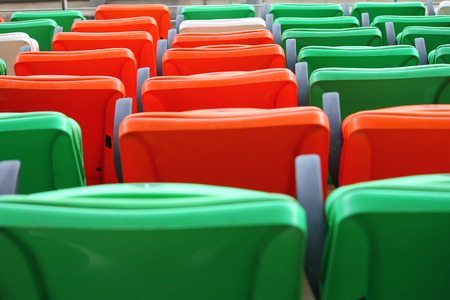 Row of Colorful seats on the stadium for watching a sport