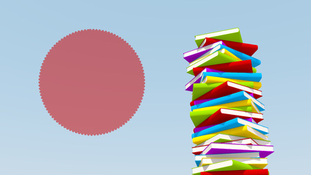 Pile of books isolated on blue background with message circle Stock Photo