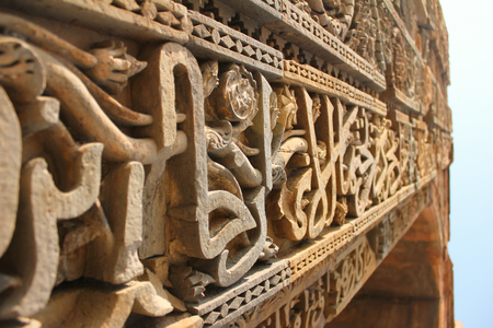 buff: Intricate work of carvings and verses from holy Quran on the red and buff sandstone of Qutab Minar
