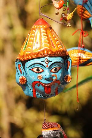 hanging face mask of goddess durga kali avatar made of clay
