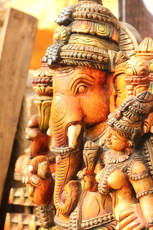 idol: Side view of colored idol of God Ganesha with goddess Ridhi Siddhi Stock Photo