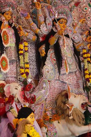 Statue of goddess durga along with Lord Ganesha and Saraswati, decorated during navratri pooja Stock Photo