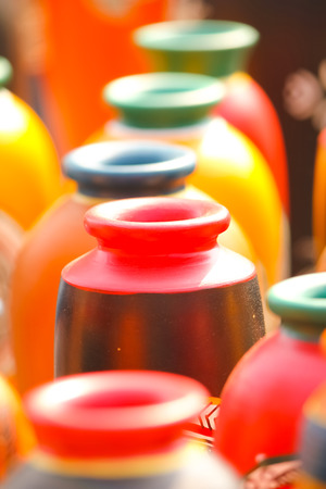 earthen: Closeup of red-brown colored earthen vase in a row; selective focus Stock Photo