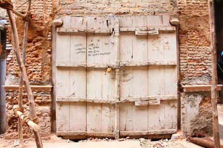 locked broken gate of old ruined house in chandini chowk
