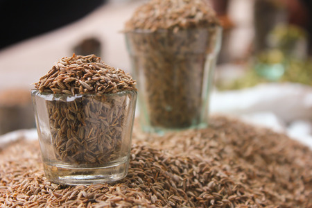 Close-up view of glass filled with Cumin seeds, jeera