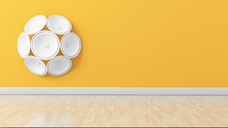 Set of white speakers in floral formation on yellow painted wall, perfect for living room interior Stock Photo