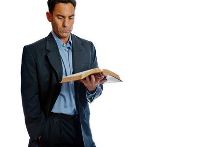 commits: Man commits to daily devotion by reading Bible.